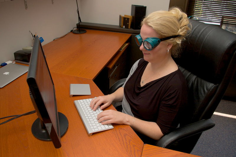 Woman at the Computer wearing a pair of LVSK goggles