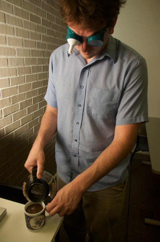 Person pouring coffee using the field restriction goggles